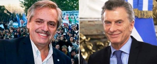 Alberto Fernández y Mauricio Macri, con sonrisas. La sociedad, con gesto adusto | Foto: Zonal Noticias.